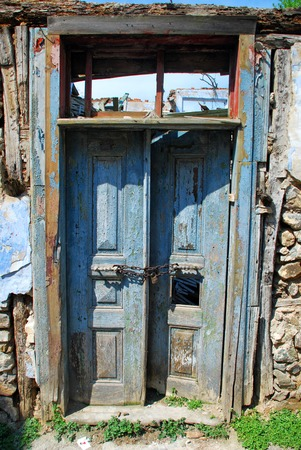 Closed old wooden weathered door Banco de Imagens