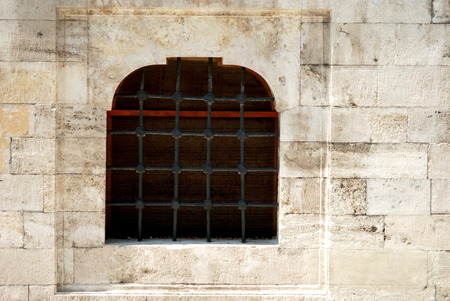 Old stone wall and window with lattice