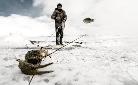 fishermen and sledding in the frozen lake Cildir
