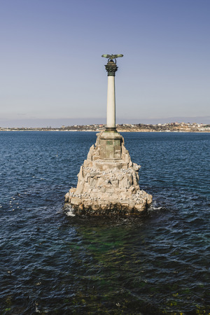war bird: Monument to the Scuttled Ships in the afternoon on a background of clear sky