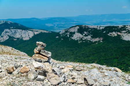 cairn: Cairn on top of a mountain overlooking the valley Stock Photo