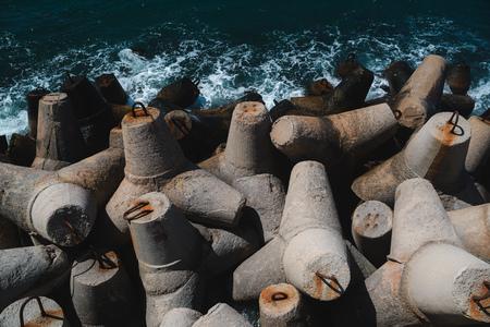 breakwater: Massive concrete interlocking tetrapods form a breakwater Stock Photo