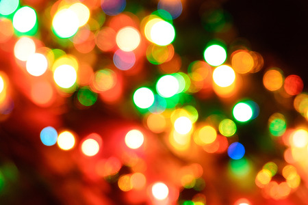 Multicolored highlights, New Years background from a garland without focus