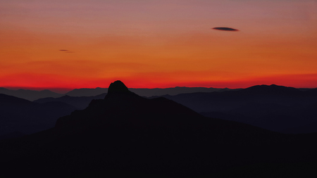 Gorgeous purple red sunset in the mountains 写真素材
