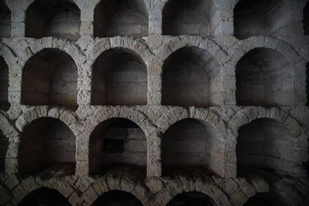 Old ancient winery, niches for bottles of wine