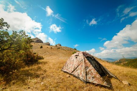 Camping tent in the camp in the parking lot, concept vacation, camping, tourism, active lifestyle