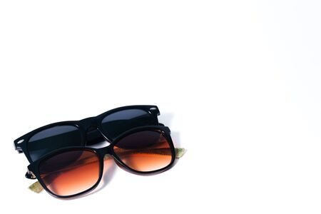 Black and brown sunglasses on a white background Stockfoto - 134027850