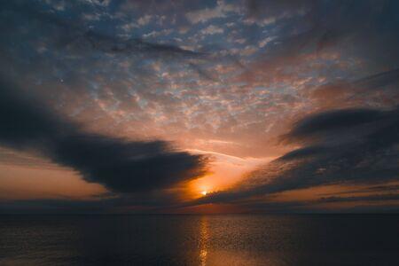 Golden sunset over the sea, cloudscape