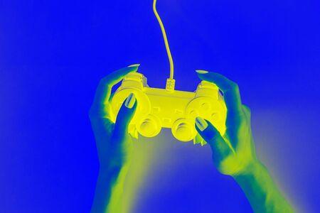 Joystick in female hands, creative design, game concept Stockfoto