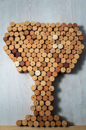 Wine glass made of wine corks on a wooden light background Stockfoto