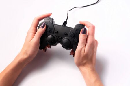 Joystick in female hands on a white background, game concept Stockfoto - 137448312