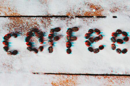 The inscription coffee made from coffee beans on sugar background in the glitch effect, mistake worry concept Stockfoto