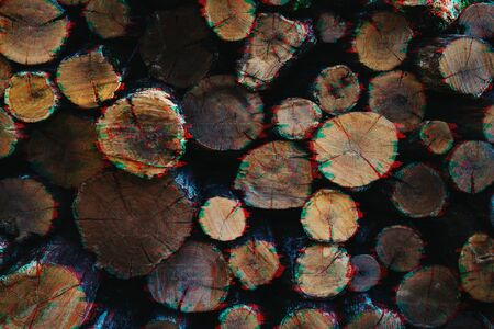Old dry round firewood in glitch effect