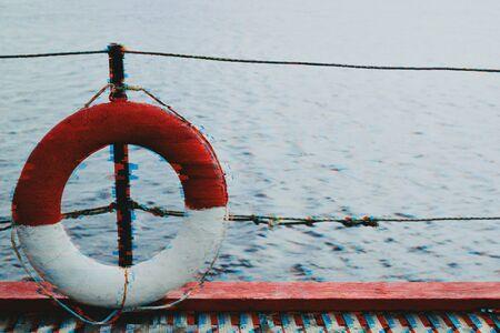 Lifebuoy on a pier against the blue sea in glitch effeck Stockfoto
