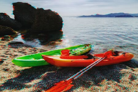 Kayaks on the sea beach in summer in glitch effect