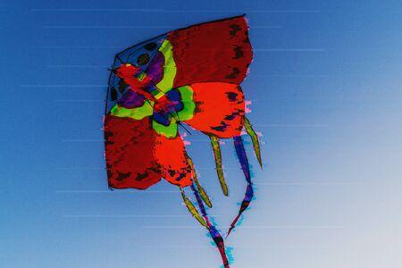 Kite in the blue sky in glitch effect