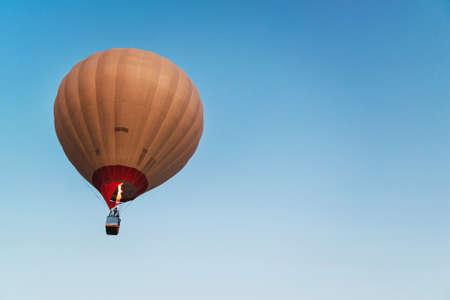 Hot air balloon in clear blue sky