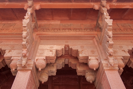 Ornate carved red stone decorates all details of the Red Fort  Agra, India photo