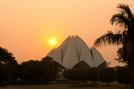 house of worship: Lotus Temple in New-Delhi at sunset  The Bahai House of Worship in Delhi, popular known as the Lotus Temple due to its flower like shape