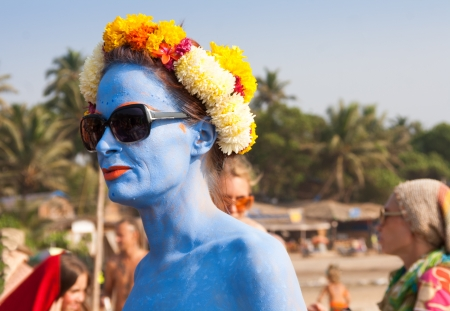 freaks: A woman with blue skin in a flower wreath at the annual festival of Freaks, Arambol beach, Goa, India, February 5, 2013  Yearly February festival of freaks in Arambol is a continuation of the traditions of hippies  Editorial