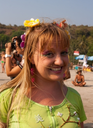 continuation: An unknown girl with flowers in her hair at the annual festival of Freaks, Arambol beach, Goa, India, February 5, 2013  Yearly February festival of freaks in Arambol is a continuation of the traditions of hippies
