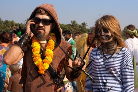 continuation: Unidentified man and woman in carnival costumes at the annual festival of Freaks, Arambol beach, Goa, India, February 5, 2013  Yearly February festival of freaks in Arambol is a continuation of the traditions of hippies  Editorial