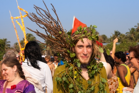 continuation: The portrait of an unidentified man in a green suit made of natural materials at the annual festival of Freaks, Arambol beach, Goa, India, February 5, 2013  Yearly February festival of freaks in Arambol is a continuation of the traditions of hippies