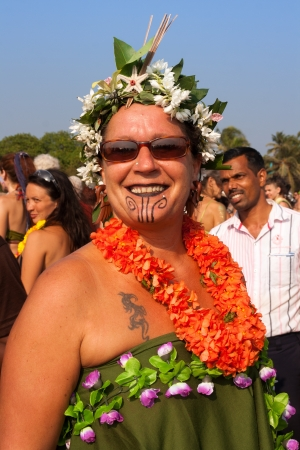 freaks: Arambol, Goa - February 5, 2013  An unidentified woman in a flower costume at the annual festival of Freaks, Arambol beach, Goa, India, February 5, 2013  Yearly February festival of freaks in Arambol is a continuation of the traditions of hippies