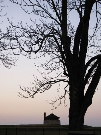 guard house: guard house and tree at Old Fort Niagara silhouetted at twilight Stock Photo