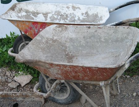 wheelbarrows used for concrete in construction work
