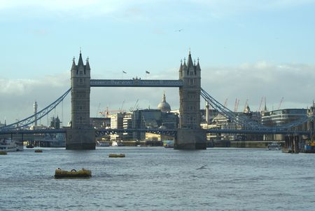 river scape: Tower Bridge in London on the Thames with Post Office Tower and the City Behind