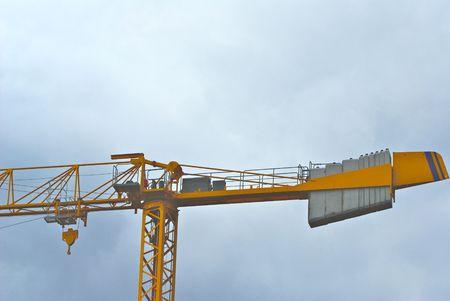 Symbol of Construction and Growth:  the Building Crane Фото со стока
