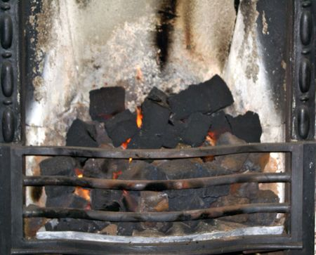 gas fireplace: Gas flames and ashes inold English gas fireplace