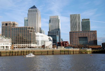 Canary Wharf and boat on the Thames River
