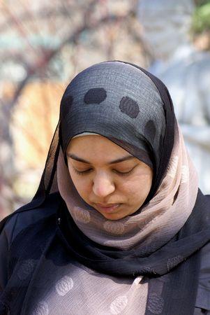 head bowed: Muslim woman with head bowed