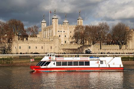 Cruise boat in front of the Tower of London