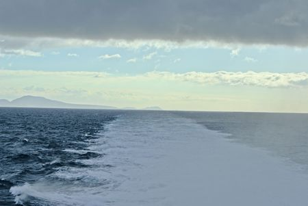 clearer: Looking back at Tenerife with water stream reaching out to clearer skies with rainy clouds overhead Stock Photo