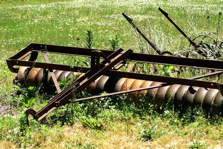 old farm equipment to level and compact soil