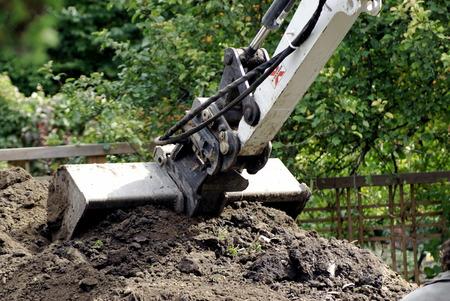 Backhoe digger voor opgraving, met vuil Stockfoto - 1685268