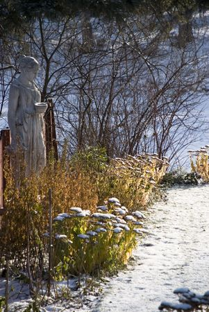 Garden Statute in First snow amongst fall vegetation Stock Photo - 2138207