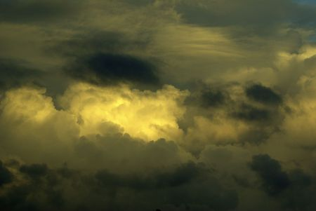 Puffy dramatic clouds with light