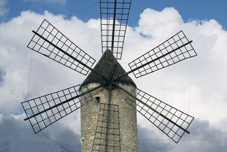 Old Spanish windmill with clouds in Mallorca