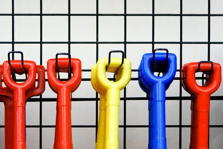 Hanging colored tool handles on a rack