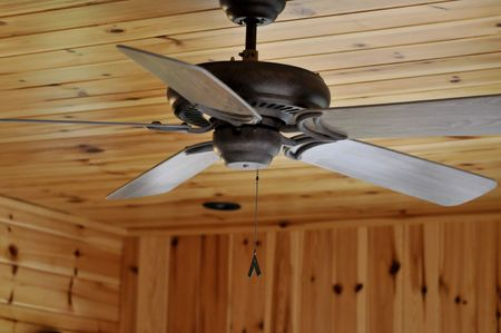 ceiling fan: ceiling fan in knotty pine room
