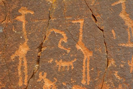 Petroglyphs or prehistoric art carved in wall in Southwest United States photo