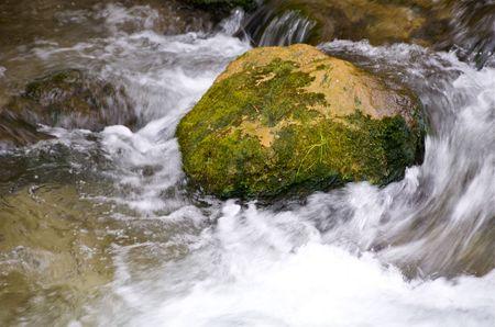 water running over rock in stream Stock fotó