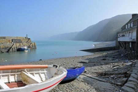 devon: Small fishing village in North Devon with boats and cliffs