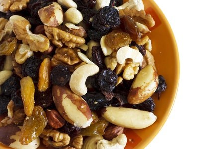 Dried fruits and nuts on the orange bowl