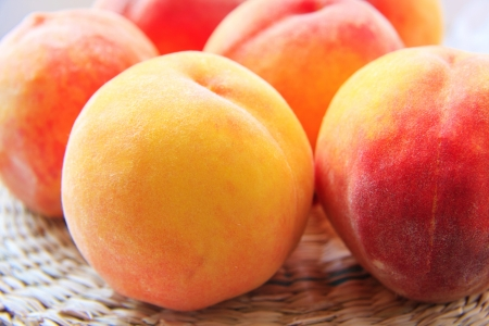 A few peaches on a table close-up Stock Photo