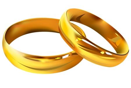 Un par de anillos de bodas de oro sobre fondo blanco